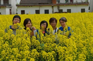Group posed in field of flowerssmall